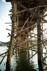 Wooden pillars of the bridge mon