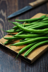 Green Beans on wooden old plank