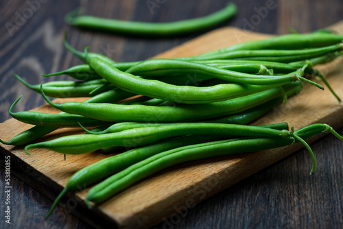 Green Beans on wooden old plank - 53810855