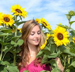 Beautiful woman loves sunflowers