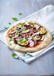 Pizza with grilled zucchini, mushrooms and pine nuts
