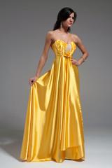 Woman in golden yellow dress