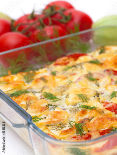 Delicious vegetables gratin in glass bowl