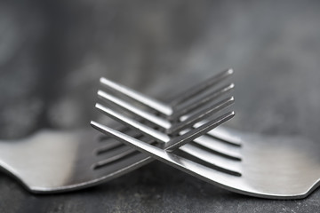 Macro image of cutlery forks on rustic background