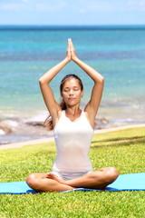 Yoga woman meditation by sea