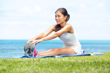 Woman training fitness stretching legs exercise