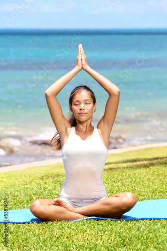 Yoga woman meditation by sea