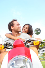 Couple driving scooter in love