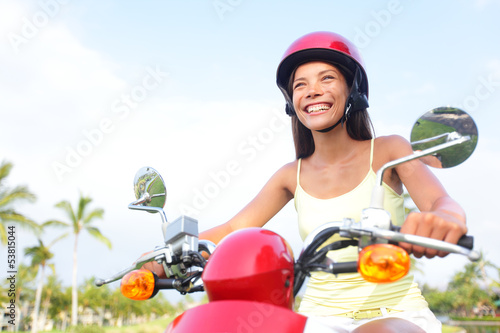 Free woman driving scooter happy
