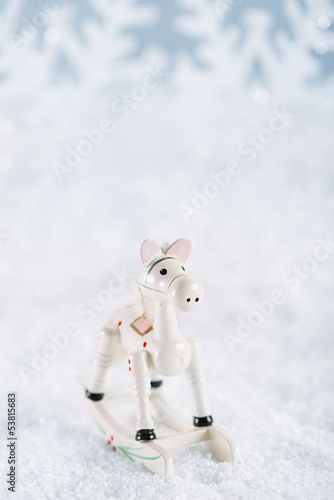horse christmas decoration on white snow background