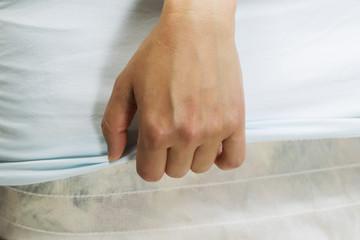 Female handing making bed