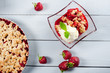 Strawberry crumble with ice cream and muesli
