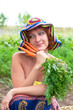 dreamy woman with bunch of fresh carrots