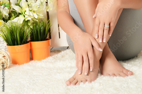 Female hands and feet with manicure and a pedicure
