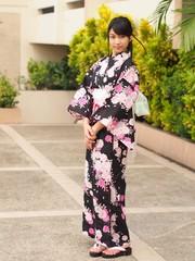 Pretty young woman wearing Japanese kimono