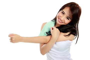 Happy young woman doing exercise