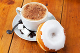 Fototapety Fresh cappuccino and doughnut with white frosting