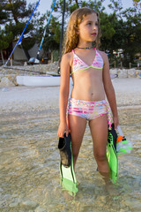 Summer sport, beach - young girl diver in the sea