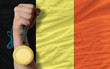 Gold medal for sport and  national flag of belgium