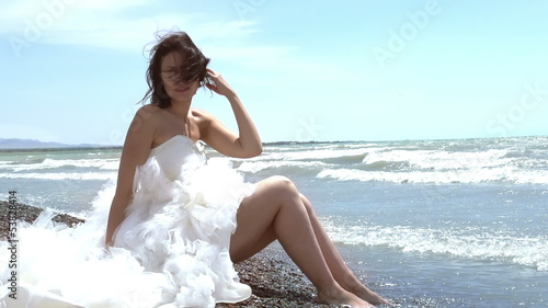 Beautiful brunette in a wedding dress. Slow Motion 240 fps