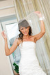beautiful smile bride in white dress open a bridal veil