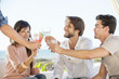 Group of friends toasting with drinks outdoors on vacation