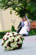elegant wedding bouquet with many roses on blur newlywed backgro