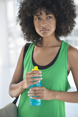 Close-up of a woman holding a water bottle