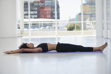 Woman practicing yoga on an exercise mat