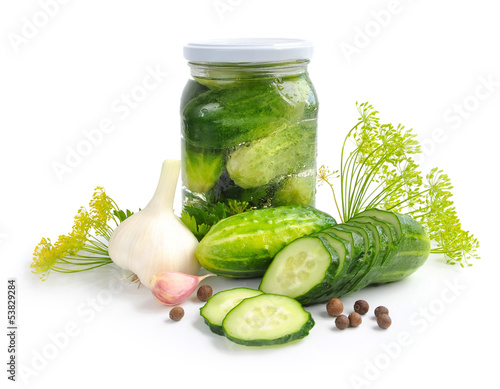 Preparing preserves of pickled cucumbers in jar with spices