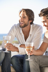 Man sitting with friends enjoying wine