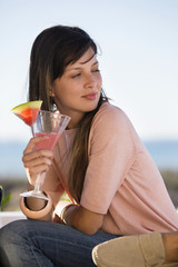Woman drinking watermelon martini