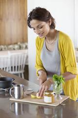 Woman preparing herbal tea in the kitchen