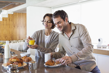 Couple having breakfast at a kitchen counter