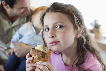 Portrait of a girl eating bread