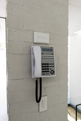 Telephone mounted on a wall