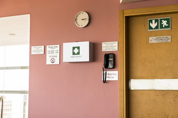 Emergency exit door with first aid kit and emergency phone