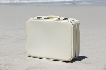Close-up of a suitcase on the beach