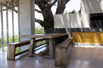 Picnic table and bench in a porch
