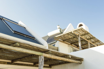 Solar panel on the roof of a house viewed from a terrace