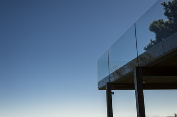 Low angle view of a terrace with glass railing