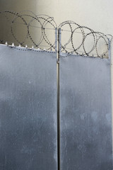 Closed door with razor wire