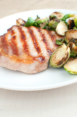 Grilled pork and brussels sprouts