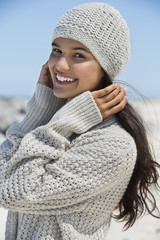 Beautiful woman on the beach in winter