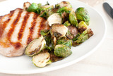 Cut brussels sprouts and pork chop