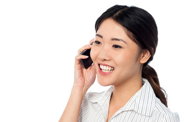 Young girl speaking over cell phone