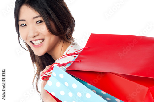 Cheerful young shopaholic girl