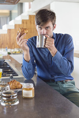 Man having breakfast at a kitchen counter