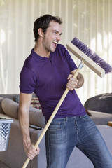 Man dancing with a mop
