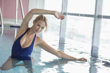 Portrait of a woman swimming in a swimming pool